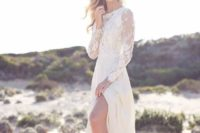 19 lace wedding dress with long sleeves and a side slit