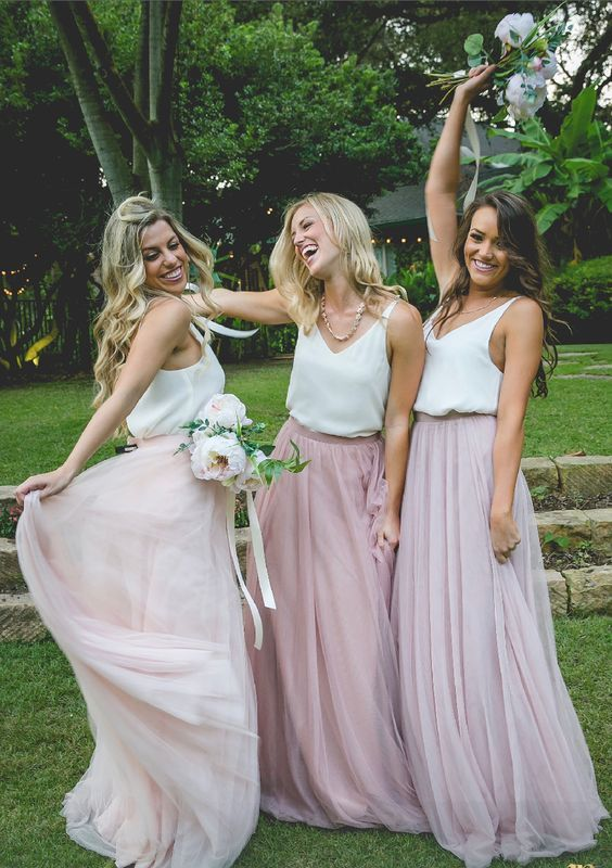 white strap tops and tulle maxi skirts in various shades of pink