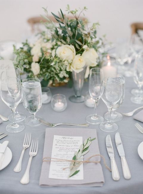 dove grey tablecloth, white flowers and neutral decor