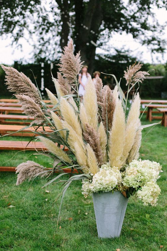 galvanized bucket with pampas and white flowers