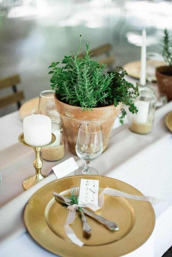 organic spring table with refined gold touches and fresh greenery