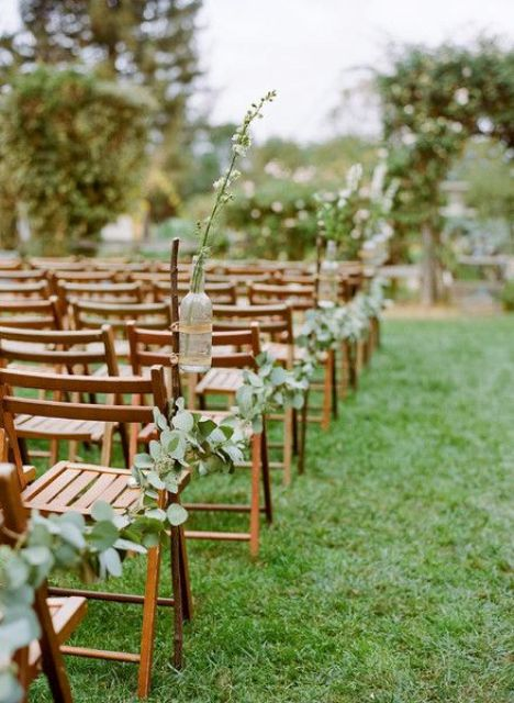 rustic wedding aisle with eucalyptus garlands