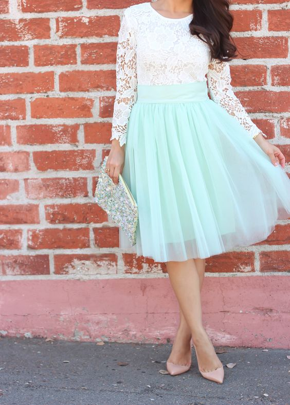 a lace top, a full tulle bloom skirt in mint green, a sequin clutch and neutral pumps