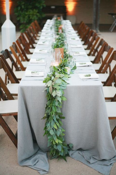 dove grey tablecloths look good with greenery like here - a long leaf table runner