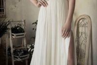 21 ivory wedding dress with a lace bodice and spaghetti straps and a side slit
