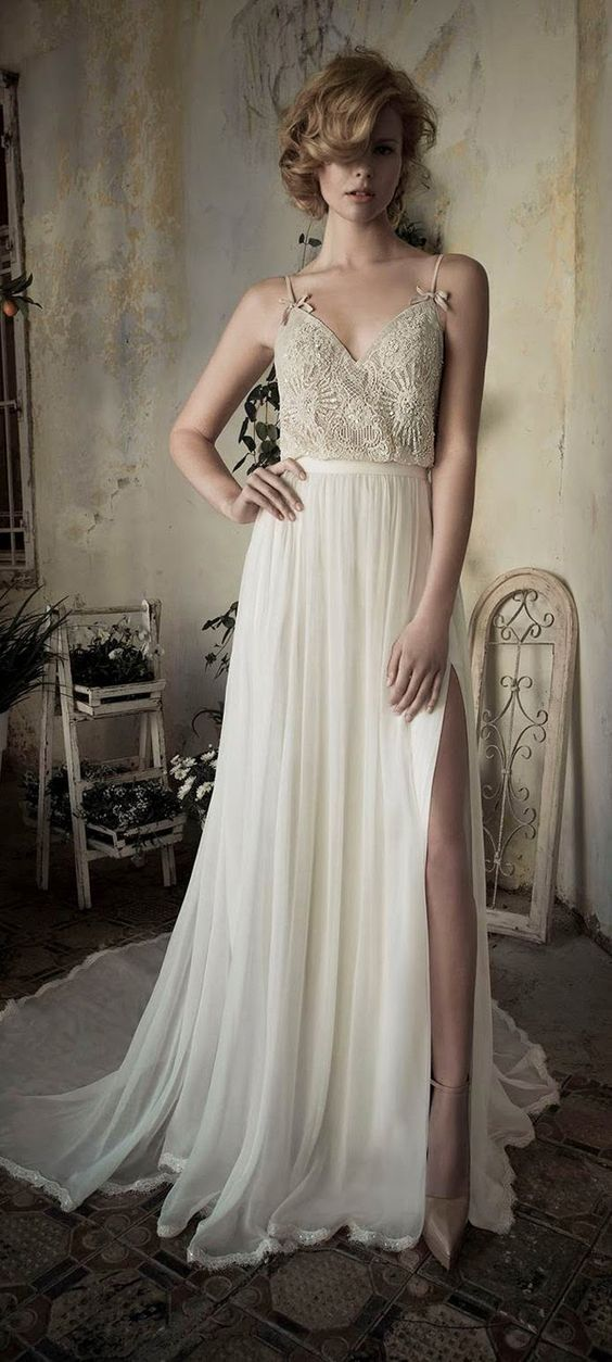 ivory wedding dress with a lace bodice and spaghetti straps and a side slit