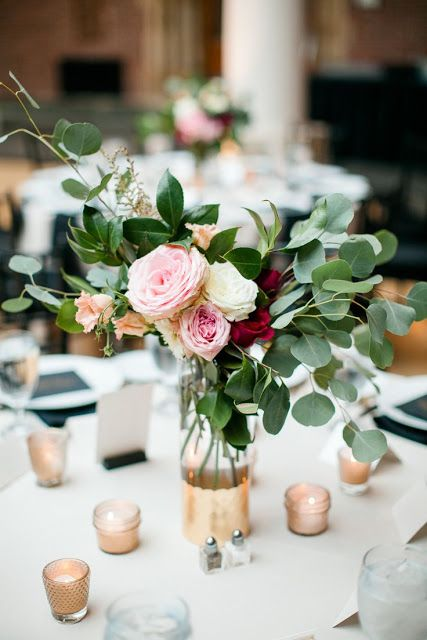 a color block metallic vase with eucalyptus and roses
