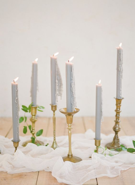dove grey candles in gold candle sticks and ethereal fabric table runner