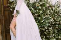 22 lace wedding dress with long sleeves, a cutout back and a thigh-high slit