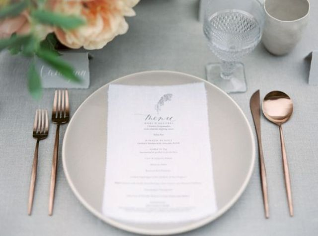 modern off-white table setting with copper tableware