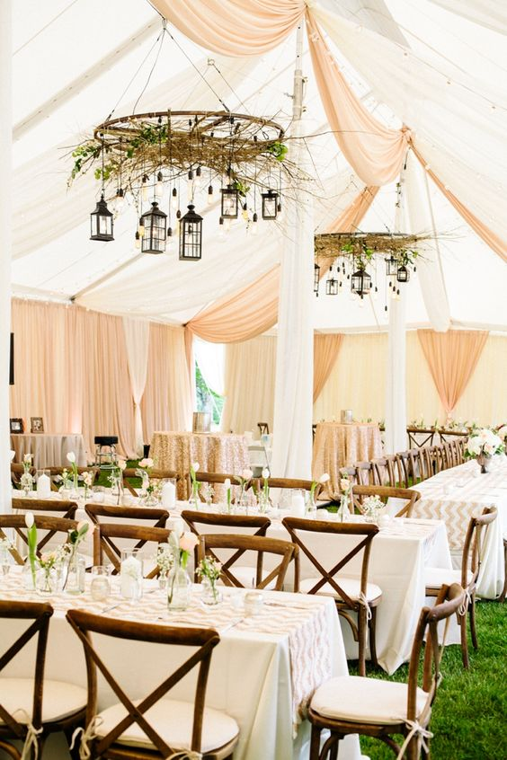 rustic chandeliers with greenery and hanging lanterns