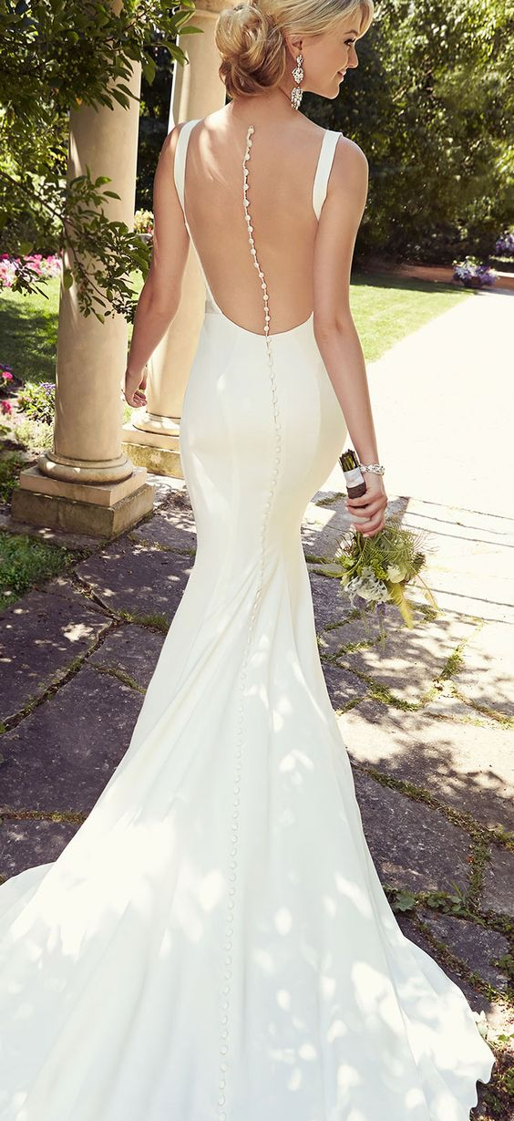 Picture Of Slinky Wedding Gown With A Stunning Rhinestone Oned Down Back