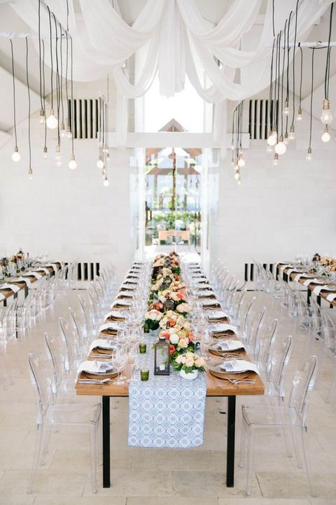 ultra-modern wedding venue in neutral colors with lucite chairs
