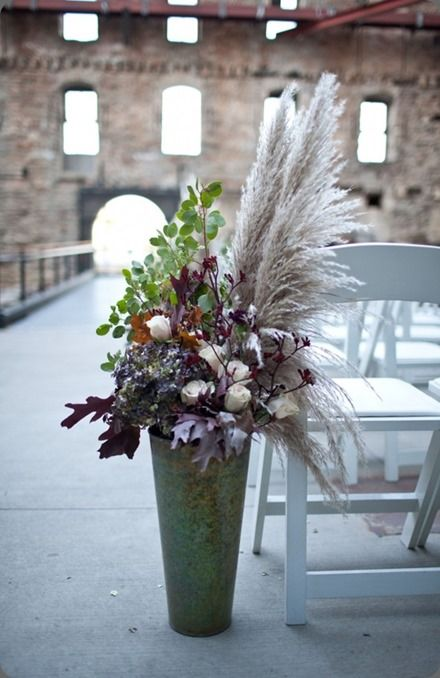 galvanized urn with pampas, leaves and flowers