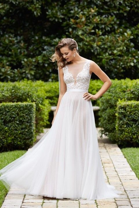 illusion plunging neckline bodice and a flowy skirt