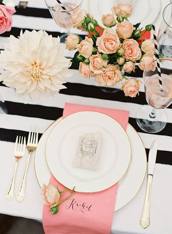 black and white table setting with pink and blush touches
