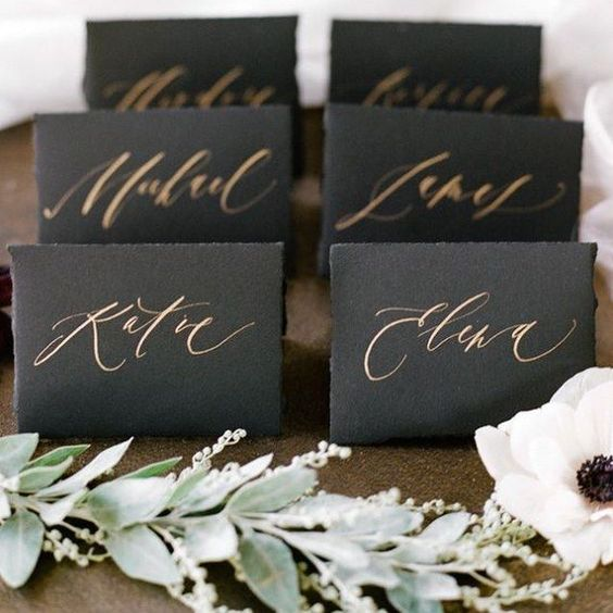 black place cards with copper calligraphy