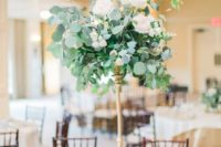 25 cute centerpiece with wwhite roses and eucalyptus