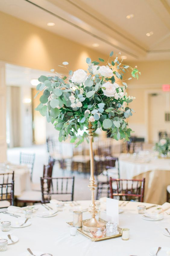 cute centerpiece with wwhite roses and eucalyptus