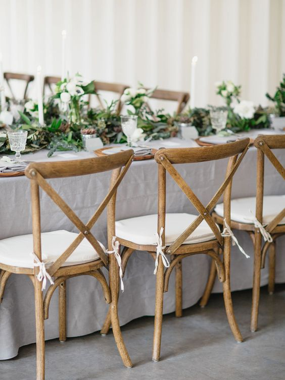 dove grey tablecloth and lots of greenery for wedding table decor