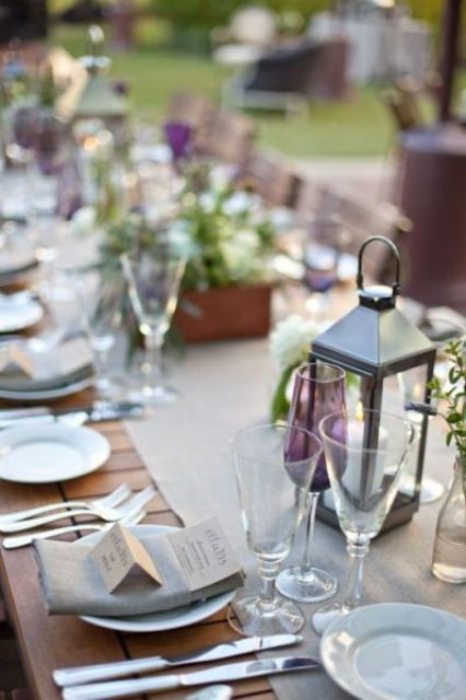 dove grey table runner and napkins, lanterns and greenery