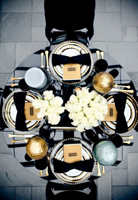 elegant black and white table decor with gold touches