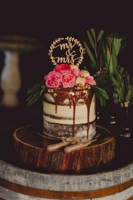 individual semi naked wedding cake with chocolate drip and fresh blooms