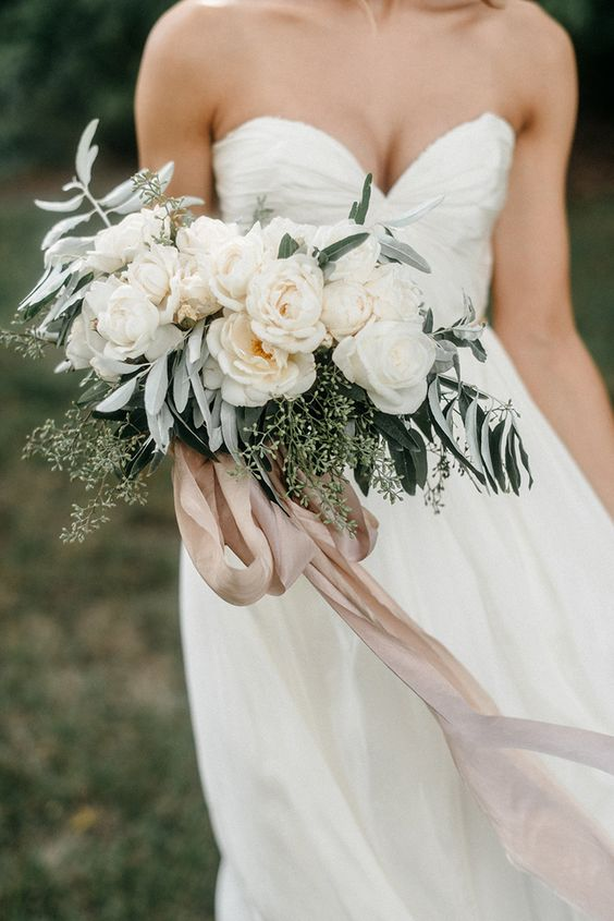 neutral wedding bouquet with blush ribbons
