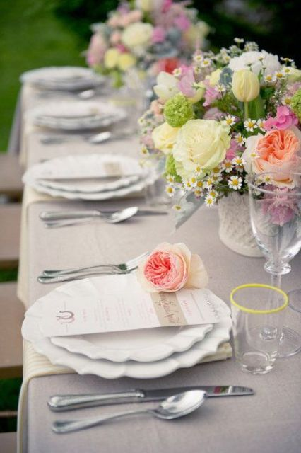 dove grey tablcloth is a neutral backdrop for anything like these bold florals