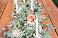27 eucalyptus garland with peachy flowers and candles