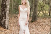27 lace applique wedding dress with spaghetti straps and a center ruffled slit