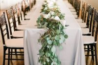 28 eucalyptus table garland with berries can substitute any centerpiece