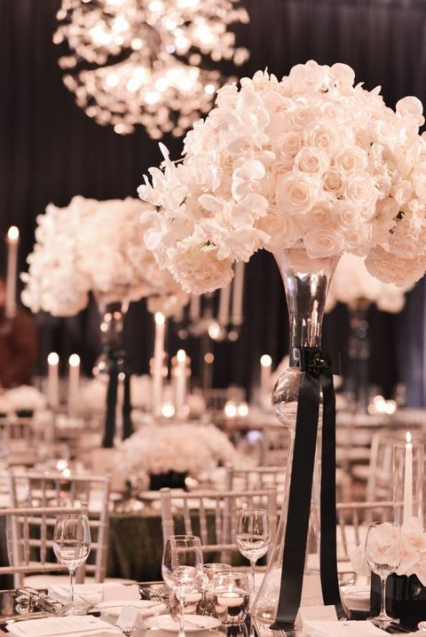 lush florals are a must for a black tie wedding, especially white or ivory ones
