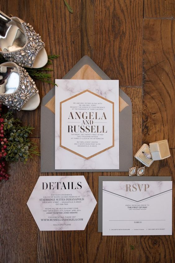 modern wedding stationary with geometric design, marble and wood prints