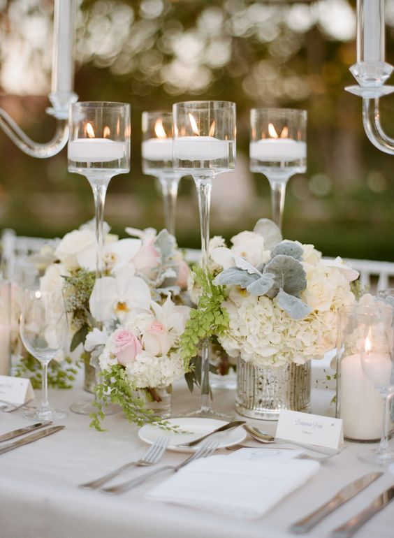 neutral tablescape with creamy flowers and candles