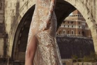 28 nude sheath dress with long sleeves and a central slit, white lace appliques