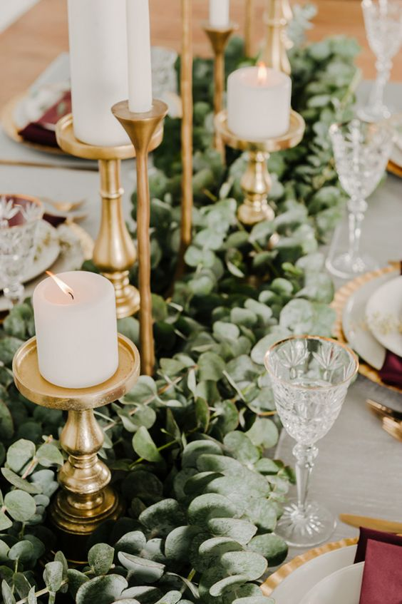 eucalyptus table garland with gold metallic candle sticks
