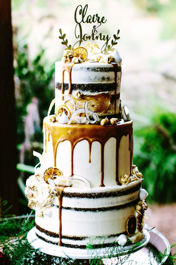 gold boho wedding cake with caramel drip, candied lemon and shaved coconut