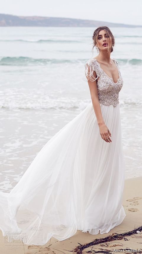 bejeweled bodice with a deep V-neck  and a flowy skirt