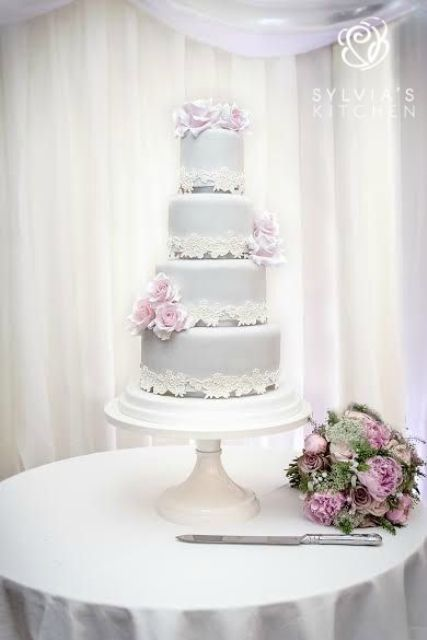 dive grey lace wedding cake with blush flowers