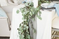 31 fabric table runner and a eucalyptus garland over it look very delicate