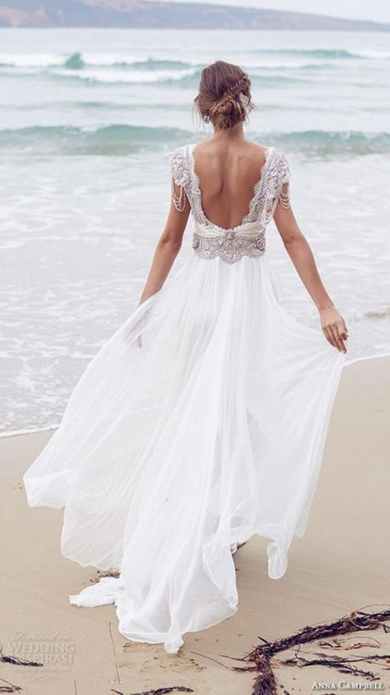 flowy wedding dress with a cutout back and a beaded bodice