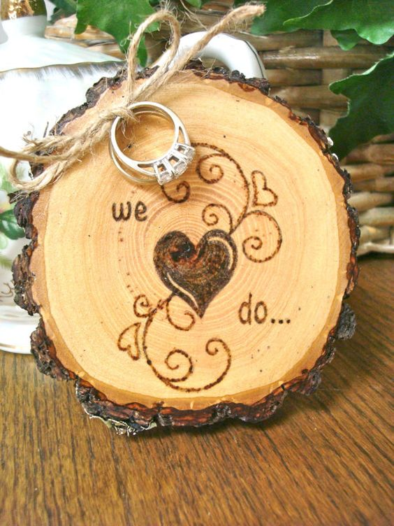 rustic wedding ring holder with wood-burnt decor