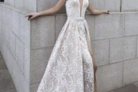 31 sleek plunging neckline lace embroidered wedding dress with a thigh-high slit