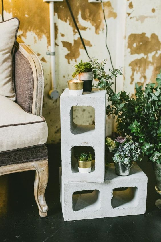 concrete stands with greenery and flowers for wedding decor