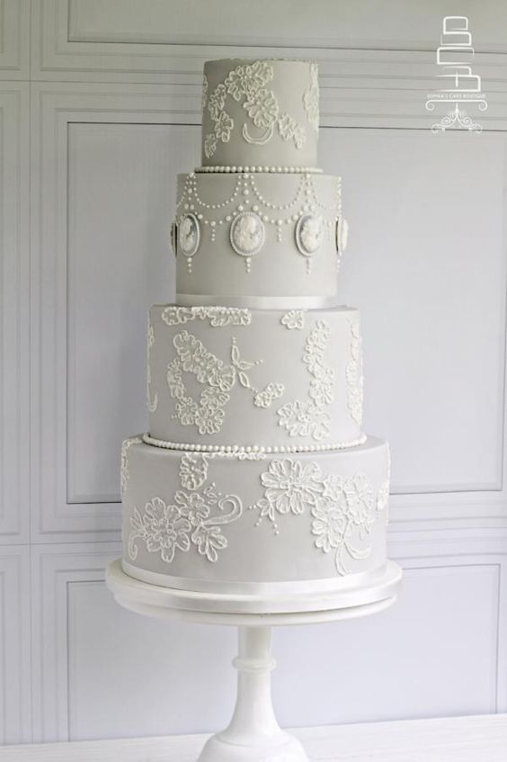dove grey vintage-inspired wedding cake with white lace decor
