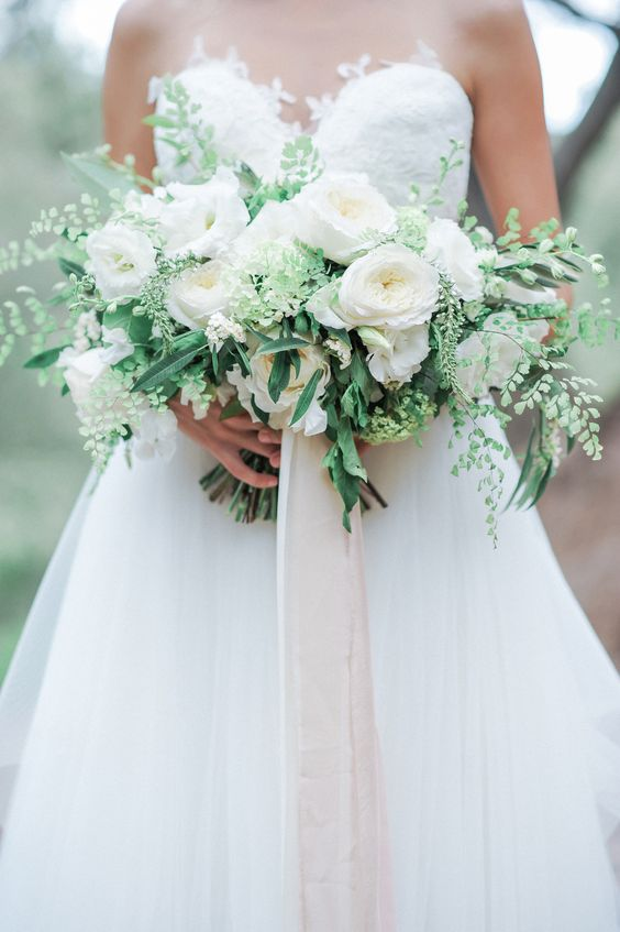 lush bridal bouquet in white and green is a perfect choice for a spring bride