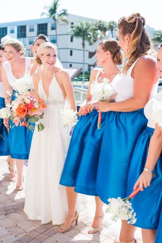 bold blue midi skirts and white tops for a seaside wedding