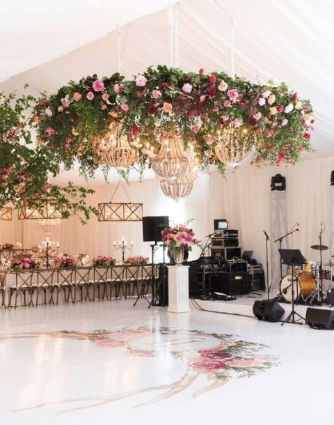 bold flower chandeliers over the dance floor to highlight it
