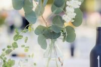 33 simple eucalyptus and flower centerpice in a sheer vase